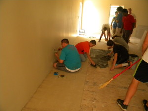 boys laying tile